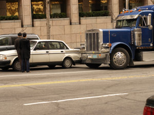 Car and semi tractor trailer in a fender bender in down town Washington DC.  - See lightbox for more